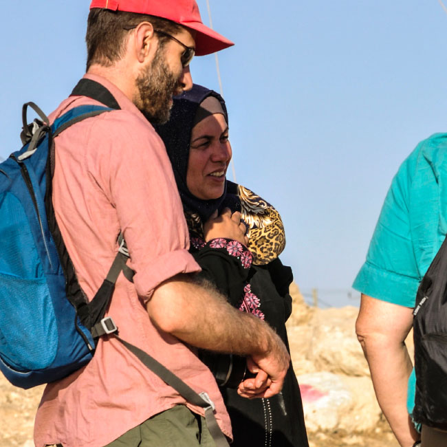 An American Jew stands in solidarity with a Muslim woman from Susiya - a Palestinian village under threat of demolition.