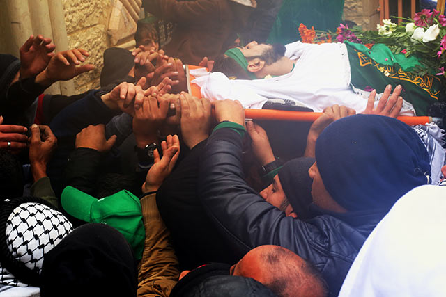 After the funeral prayers are completed, the bodies are carried into the Martyrs Cemetary, where they are buried in a joint burial.